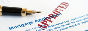 This picture shows a pen and a mortgage application for the purchase of a residential home.